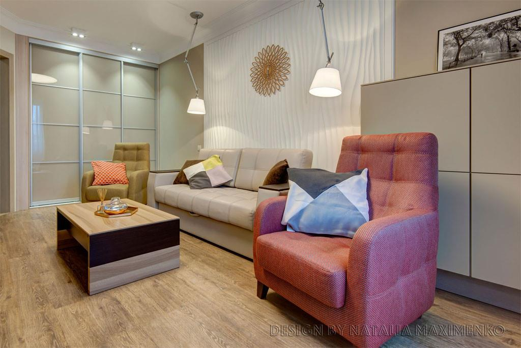 Основным декоративным элементом в комнате стала 3D-панель и дизайнерские светильники.