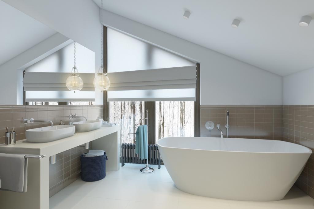 Прелестная ванная комната с отдельно стоящей ванной, душевой и просторной столешницей с двумя раковинами.