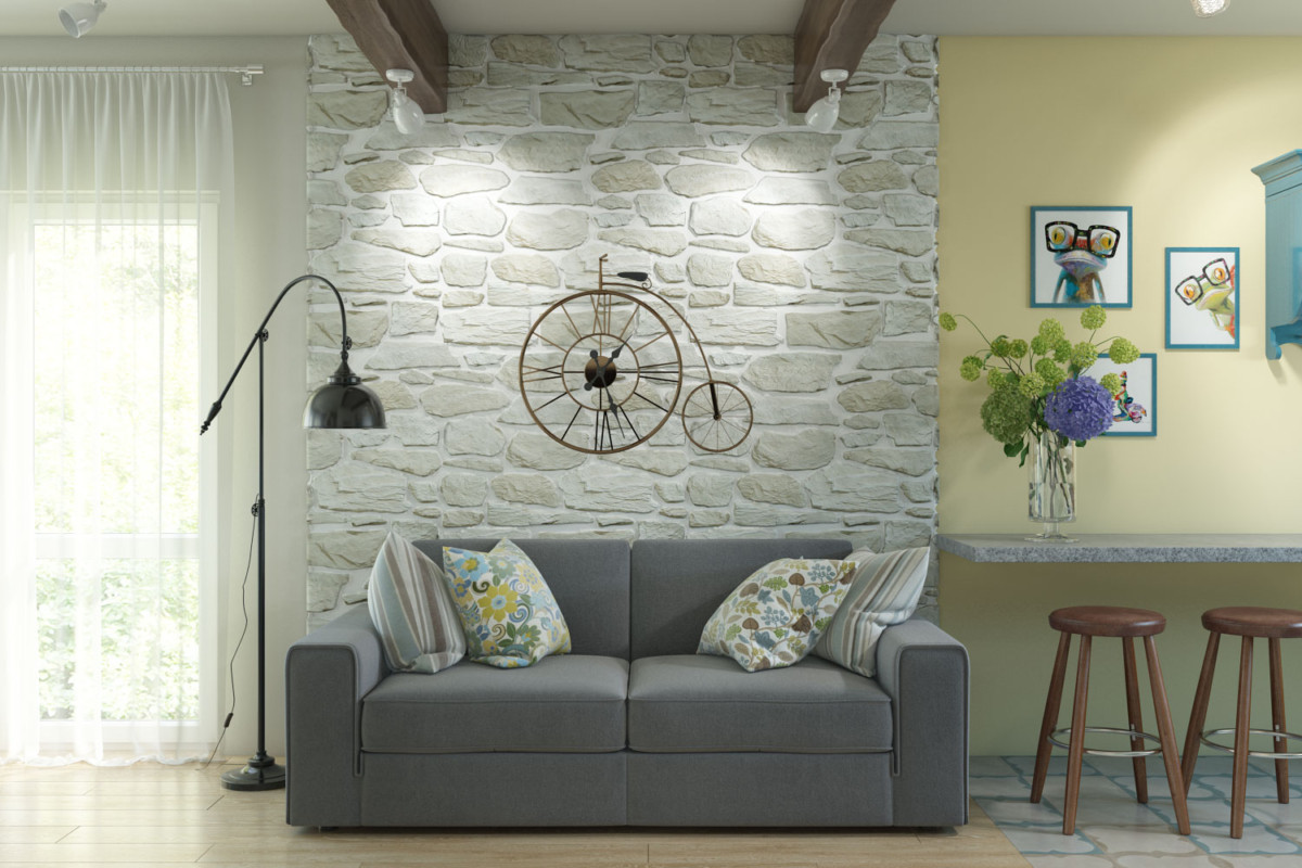 Зона гостиной, диван и телевизор. Стену декорировали камнем, разместили панно «Велосипед».