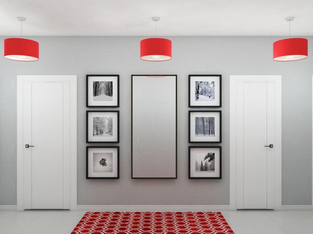 Прихожая решена в серых тонах. Чёрно-белые фотографии и светильник в красном абажуре создают яркую композицию.